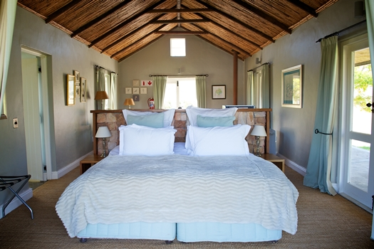 Pumphouse honeymoon cottage bed at South Hill